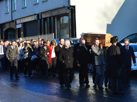 Mourners at the funeral of Darren Taylor in Coagh