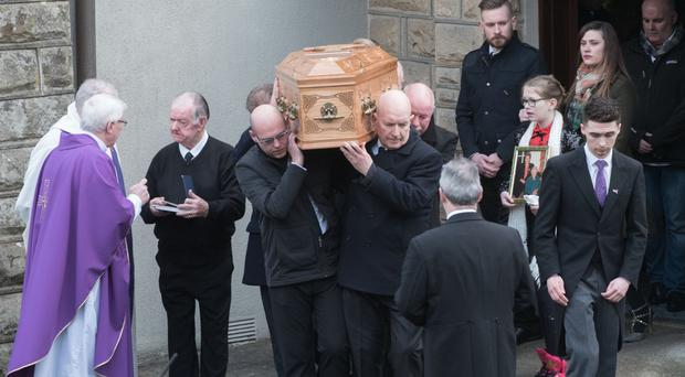 Family members at the funeral of Loreto Douglas, who died following a road accident on the Glenshane Pass last week. The funeral was at the Church of the Immaculate Conception in Derry