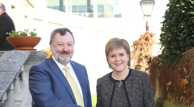 Cathaoirleach of the Seanad Senator Denis O'Donovan greets First Minister of Scotland Nicola Sturgeon at Leinster House, Dublin