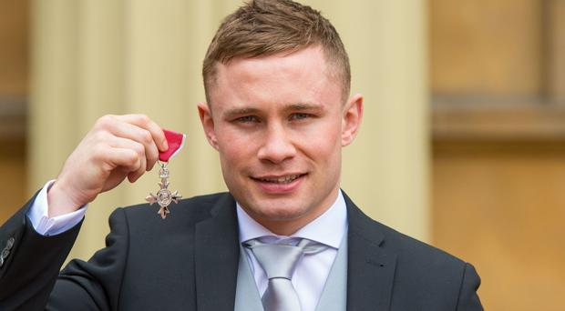 Boxer Carl Frampton with his MBE medal awarded by the Duke of Cambridge