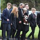 Family and friends of Reece Meenan escort the coffin at his funeral at Star of the Sea Church in Portstewart yesterday