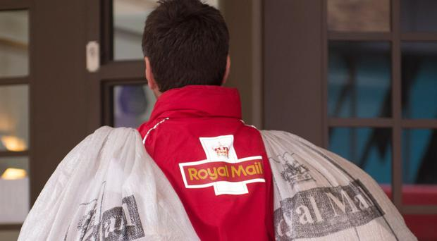 One of the men wore a Royal Mail coat.
