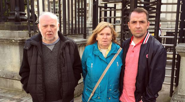 Pearse Jordan's father Hugh, mother Teresa and brother Matt outside the Royal Courts of Justice in Belfast