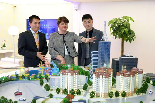 Arlene Foster with Li Peny and Hanson Hu of Huawei Technologies during a tour of the Huawei Shanghai R&D Centre