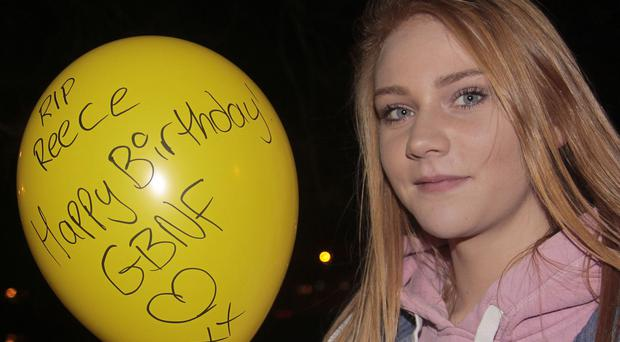 Rebecca McClelland with a birthday balloon in memory of Reece Meenan