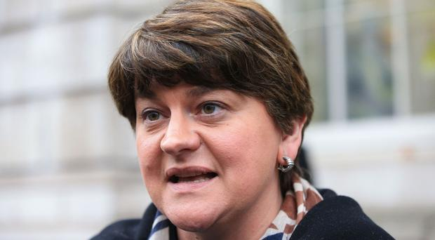 Arlene Foster was criticised by political rivals after she was pictured beside Dee Stitt at an SIF-linked photocall