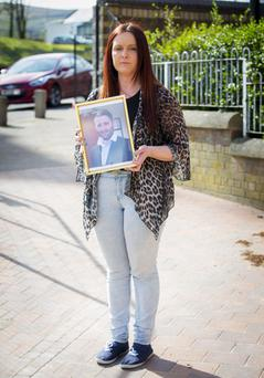 Joanne McGibbon holds a picture of husband Michael
