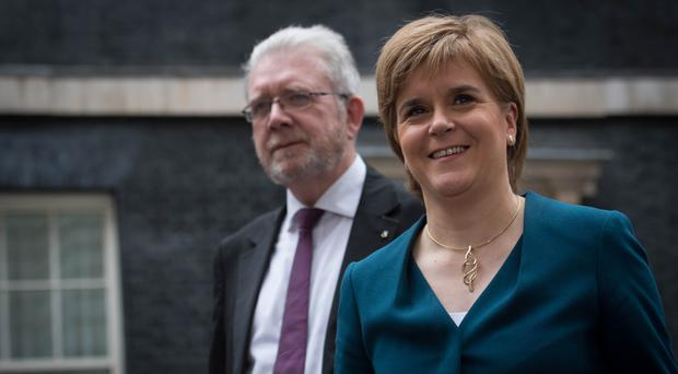 First Minister of Scotland Nicola Sturgeon leaves 10 Downing Street after a Joint Ministerial Council meeting which she called