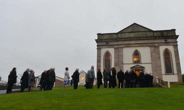 Mourners arriving at the service
