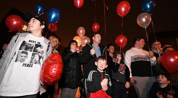 Christopher Meli's parents Vanessa and Christopher along with family and friends release balloons outside their house in west Belfast to mark the first anniversary of his death
