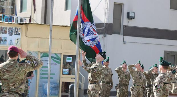 The flag is raised as the 1st Battalion The Royal Irish Regiment takes over in Kabul