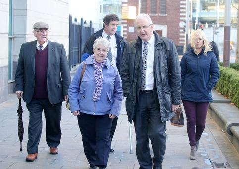 The UUP's Danny Kennedy (front right) with May Quinn and other relatives of those killed in the Kingsmill massacre
