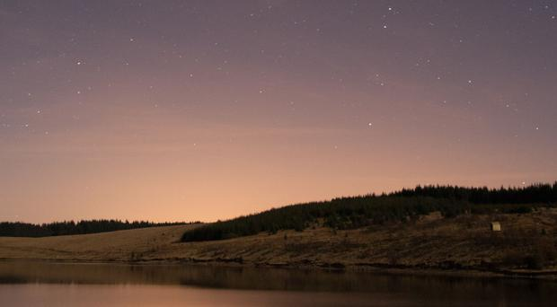 Stars in the night sky above Kielder Water, Northumberland.