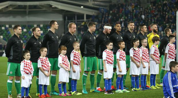 The Northern Ireland players as the anthem, God Save the Queen, is played before kick-off at Windsor Park