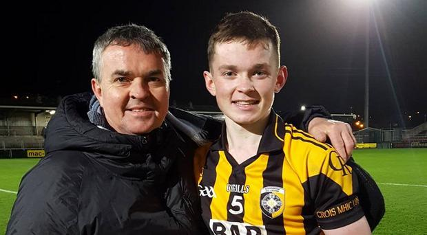 Ruairi O'Neill shows off the Armagh u21 trophy with his father Kevin