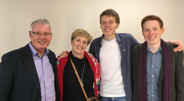 Andrew Smyth with his parents Nigel and Kay and brother Jamie