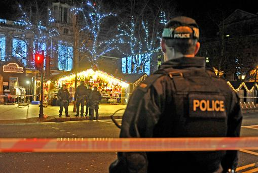 Police at the scene of the stabbing at Belfast's Christmas Market last night