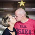 Ryan Farquhar and his wife Karen share a kiss