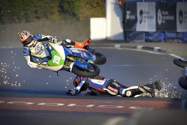 Ryan Farquhar (grounded) and English rider Dan Cooper crash during the NW200 Supertwins race. Cooper escaped with relatively minor injuries