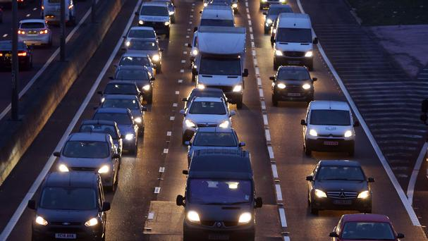 Traffic builds up on the M25 motorway near Dartford in Kent on a predicted evening of travel problems across the UK
