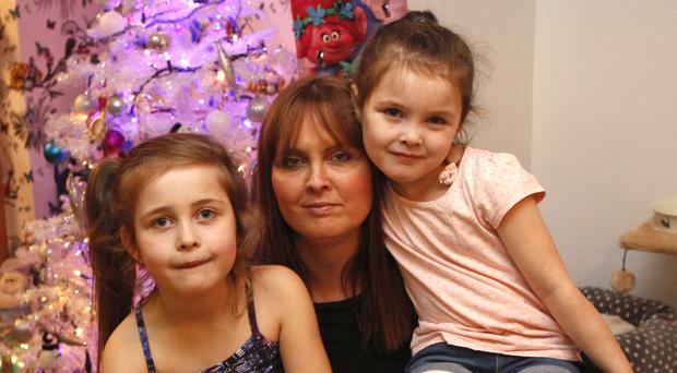 Joanne McGibbon with children Michaela (left) and Corry-Leigh