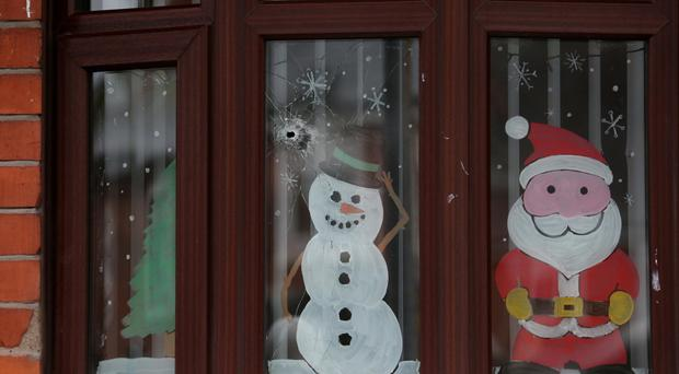 A bullet hole in the window of a house in west Belfast