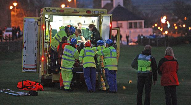 The injured man is carried to an ambulance