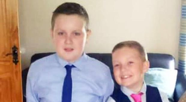 Ben and Rhys Mullan who were caught up in the fire at Seacoast Road, Magilligan