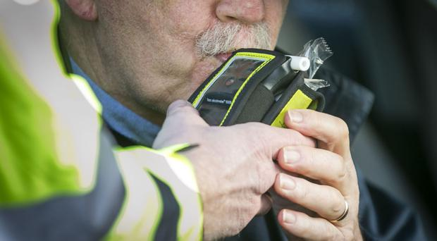 A driver is breathalysed at a checkpoint in Belfast. (File photo)