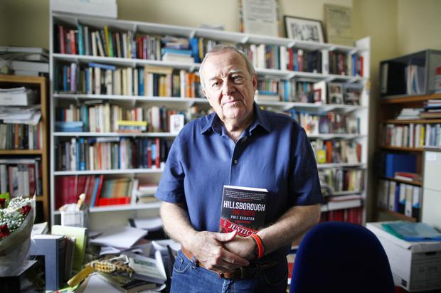 Professor Phil Scraton with his book Hillsborough: The Truth
