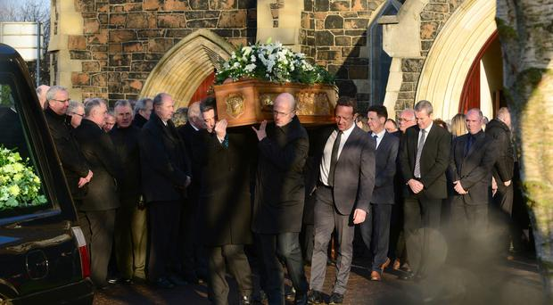 Mourners at the funeral of former Irish League footballer Davy Smyth