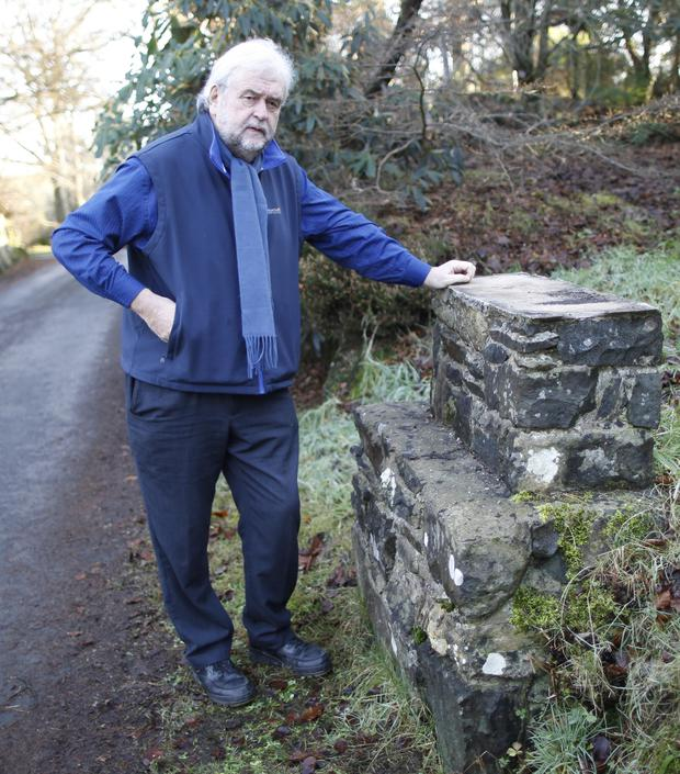 Belfast Telegraph Journalist Ivan Little at the entrance to Rowallane gardens, Saintfield, from were the stone lions have been stolen.