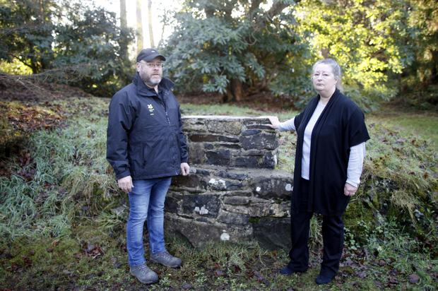 Assistant head gardener Malcolm Simms and National Trust member Jane Wright at spot from where the lions were stolen
