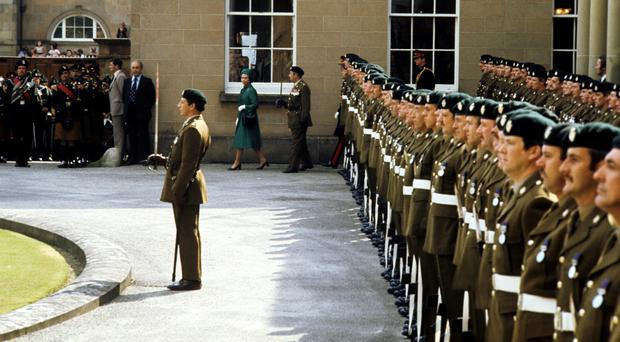 Members of the Ulster Defence Regiment mount a guard of honour for the Queen at Hillsborough Castle in 1977