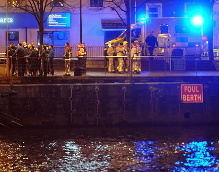 Rescue services at the Lagan Weir last night during the serach for a missing man