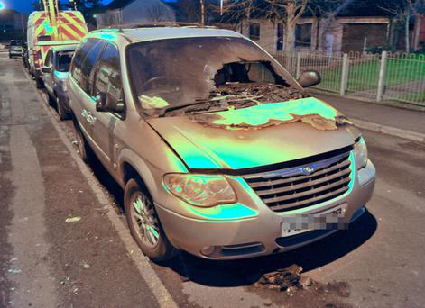 A Chrysler Grand Voyager was one of three vehicles wrecked in overnight arson attacks in Holywood