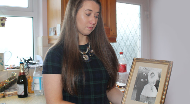 Danielle Hamilton with a picture of her grandfather David Graham and her grandmother on their wedding day