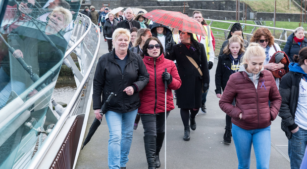 The Walk of Freedom makes its way across the Peace Bridge in Derry