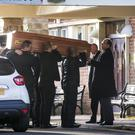 Joanne Bowman's coffin is carried into Roselawn Crematorium