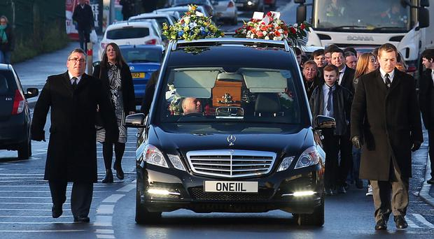 The funeral of Gerard Hall makes its way to St Agnes' Church in Andersonstown