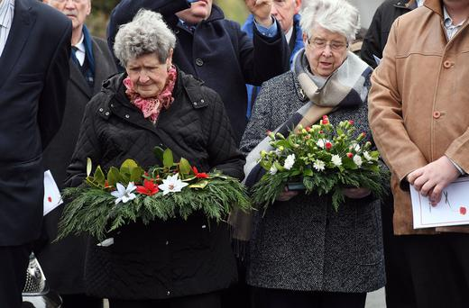 Relatives of Kingsmills victims lay wreaths at the memorial service to mark the 41st anniversary of the massacre