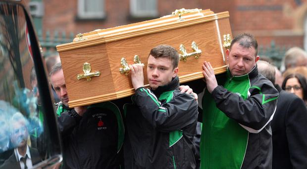 The funeral cortege of John Kelly as members of St George's ABC carry his coffin