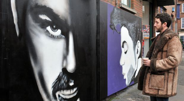 Neil Bickerstaff looks at the George Michael mural on his barber's shop