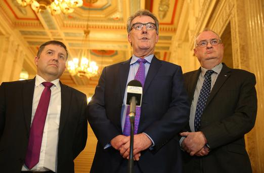 Ulster Unionist leader Mike Nesbitt and party members in the great hall at Stormont