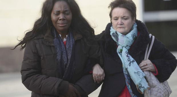 Great sadness: Matthew's wife and mother during the trial