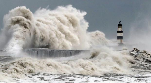 Waves crash into the sea wall at Seaham Harbour