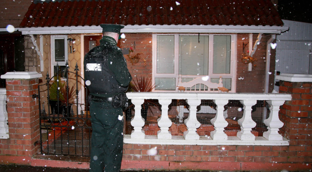 Police at the scene of a shooting in the Norglen Parade area of west Belfast last week