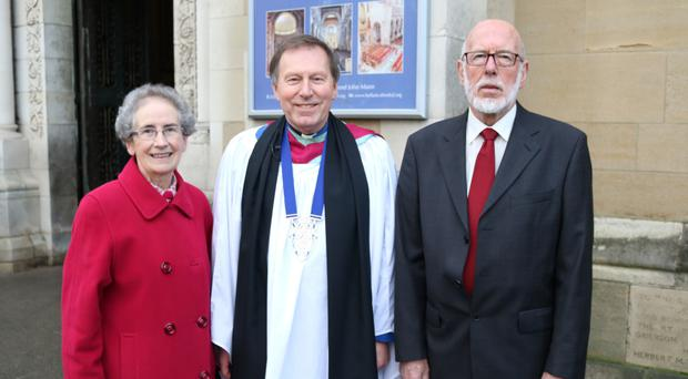 Myrtle Kerr, Dean John Mann and Robert Kay at St Anne's Cathedral in Belfast yesterday