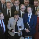DUP leader Arlene Foster with party members at Stormont yesterday morning