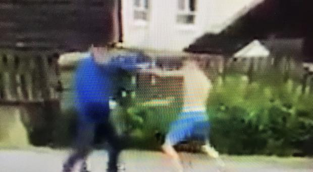 Footage of the fight outside St Kieran's Primary School at Laurelbank in Poleglass. Police are investigating and have made two arrests